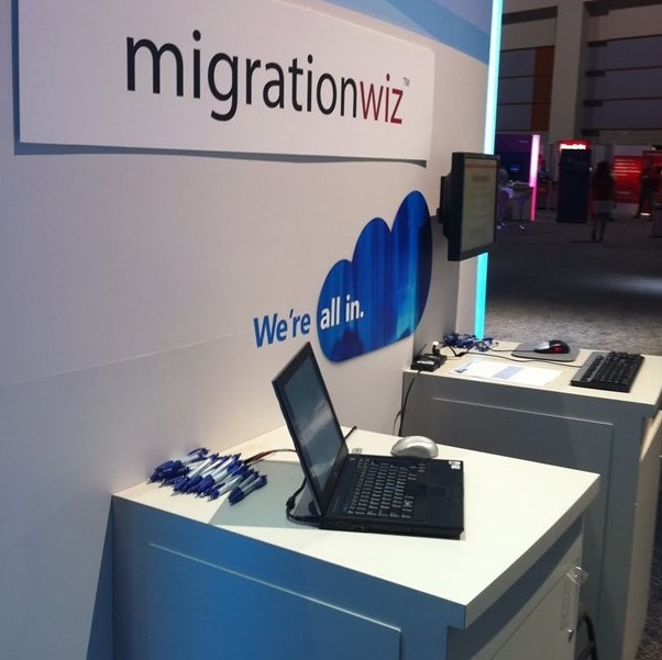 Cropped photo of a MigrationWiz trade show booth demo station.